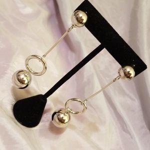 Silver tone statement earrings